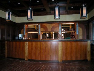 Custom art deco style bar front in front of restored bar cabinets